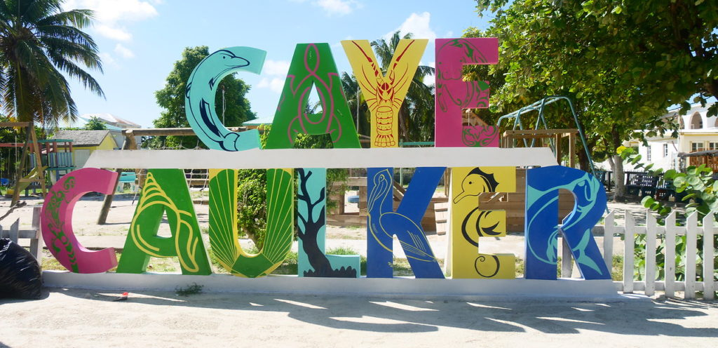 Caye Caulker sign in big letters on the beach